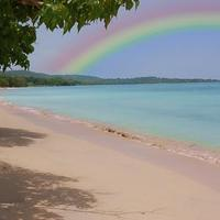 Added a rainbow to make the beach look more appealing cover